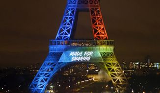 "FILE - In this Feb.3, 2017 file photo, the Eiffel Tower lit up with colors for the Paris 2024 bid during the launch of its campaign as candidate for the 2024 Olympic summer games in Paris. Groups defending the French language are lodging legal protests over the English-only slogan used by Paris authorities bidding for the 2024 Olympics. Lawyer Emmanuel Ludot said Friday Feb; 17, 2017 that he has submitted a request with the government's rights defense authority to suspend use of the slogan ""Made for Sharing."" (AP Photo/Francois Mori)"