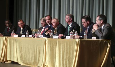 From left, Chuck Smith, John Adams, Frank Wagner, Corey Stewart, Denver Riggleman, Ed Gillespie, Bryce Reeves and Glenn Davis debate during the Millennial Advocacy Council PAC and NextGen GOP statewide candidate debate Saturday, Feb. 18, 2017, in Charlottesville, Va. (Ryan M. Kelly/The Daily Progress via AP)