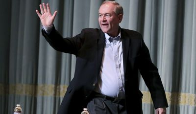 Former Gov. Jim Gilmore waves as he is introduced to speak before the Millennial Advocacy Council PAC and NextGen GOP statewide candidate debate Saturday, Feb. 18, 2017, in Charlottesville, Va. (Ryan M. Kelly/The Daily Progress via AP)