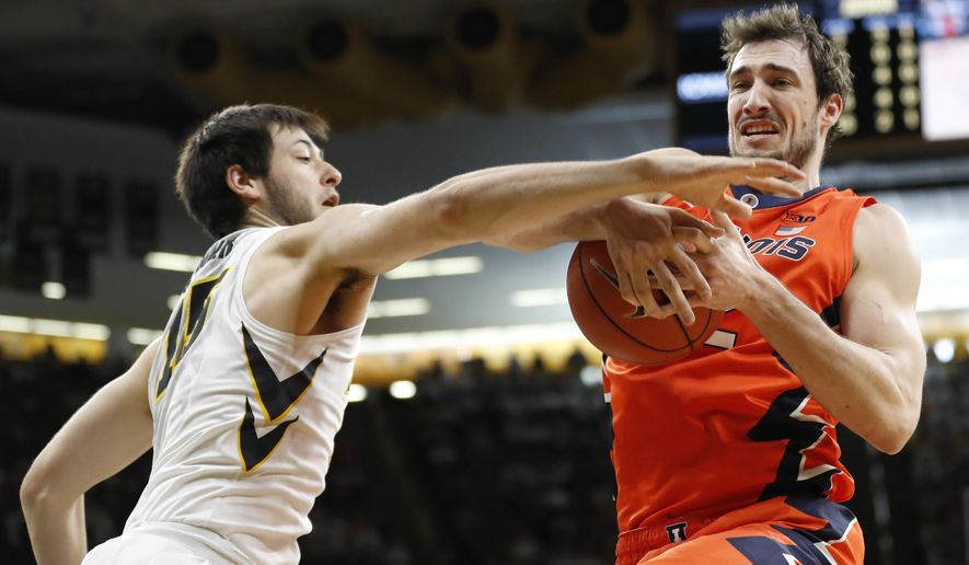 Illinois center Maverick Morgan, right, fights for a rebound with Iowa forward Ryan Kriener, left, during the first half of an NCAA college basketball game, Saturday, Feb. 18, 2017, in Iowa City, Iowa. (AP Photo/Charlie Neibergall)