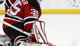 New Jersey Devils goalie Cory Schneider (35) blocks a penalty shot by New York Islanders center John Tavares during the first period of an NHL hockey game, Saturday, Feb. 18, 2017, in Newark, N.J. (AP Photo/Julio Cortez)