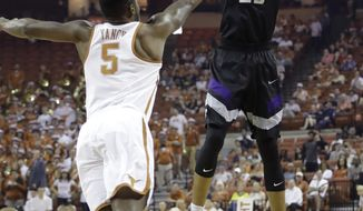 Kansas State forward Wesley Iwundu (25) shoots over Texas guard Kendal Yancy (5) during the first half of an NCAA college basketball game, Saturday, Feb. 18, 2017, in Austin, Texas. (AP Photo/Eric Gay)