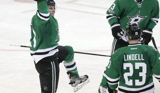 Dallas Stars left wing Antoine Roussel (21) celebrates scoring his third goal of the night with teammates Esa Lindell (23) and John Klingberg (3) during the third period of the Stars' NHL hockey game against the Tampa Bay Lightning in Dallas, Saturday, Feb. 18, 2017. The Stars won 4-3 in overtime. (AP Photo/LM Otero)