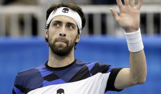 Nikoloz Basilashvili, of Georgia, waves to fans after defeating Mikhail Kukushkin in a semifinal at the Memphis Open tennis tournament Saturday, Feb. 18, 2017, in Memphis, Tenn. Basilashvili defeated Kukushkin 7-6 (5), 6-1. (AP Photo/Mark Humphrey)