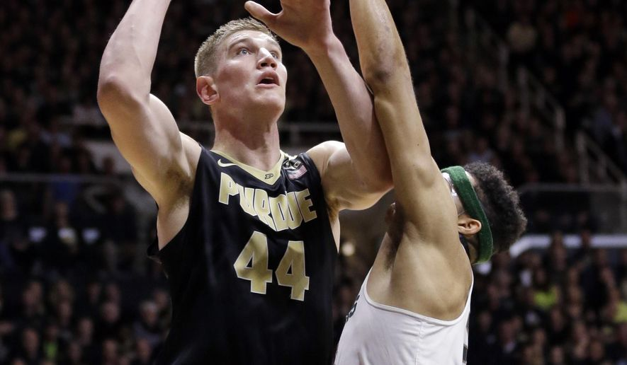 Purdue center Isaac Haas (44) shoots over Michigan State forward Kenny Goins (25) in the second half of an NCAA college basketball game in West Lafayette, Ind., Saturday, Feb. 18, 2017. Purdue defeated Michigan State 80-63. (AP Photo/Michael Conroy)