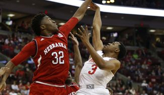 Nebraska center Jordy Tshimanga, left, blocks a shot by Ohio State guard C.J. Jackson during the second half of an NCAA college basketball game in Columbus, Ohio, Saturday, Feb. 18, 2017. (AP Photo/Paul Vernon)