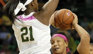 Baylor's Kalani Brown (21) defends as Oklahoma State's Kaylee Jensen (54) drives to the basket in the first half of an NCAA college basketball game, Saturday, Feb. 18, 2017, in Waco, Texas. (AP Photo/Tony Gutierrez)