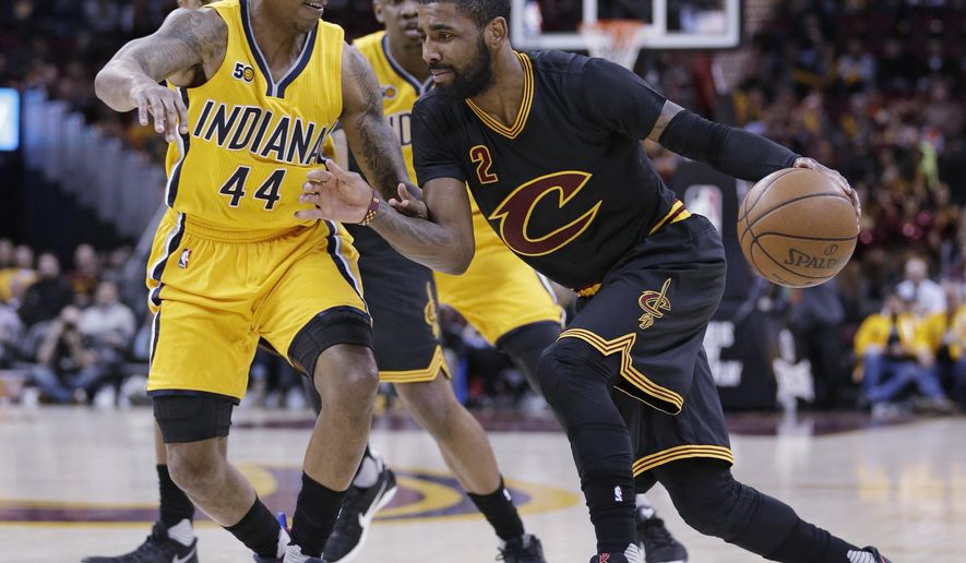 Cleveland Cavaliers' Kyrie Irving, right, drives past Indiana Pacers' Jeff Teague in the first half of an NBA basketball game, Wednesday, Feb. 15, 2017, in Cleveland. The Cavaliers won 113-104. (AP Photo/Tony Dejak)