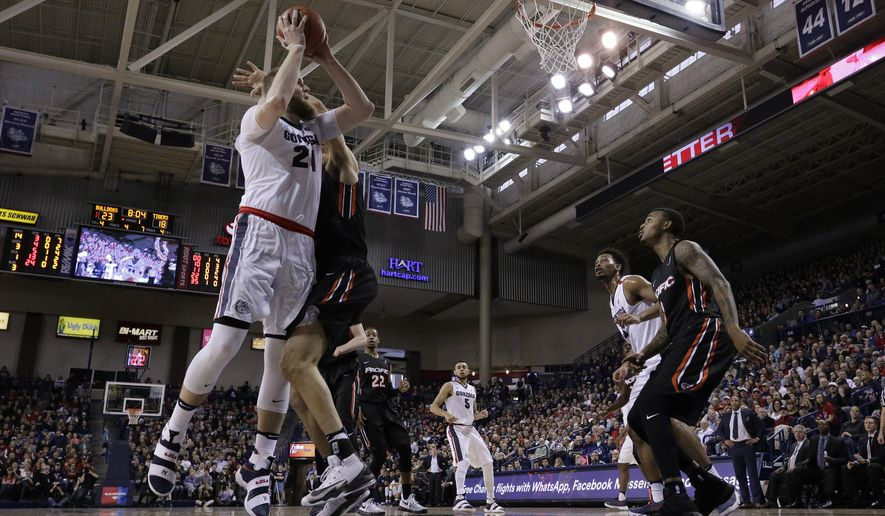 Gonzaga center Przemek Karnowski (24) shoots against Pacific center Sami Eleraky during the first half of an NCAA college basketball game in Spokane, Wash., Saturday, Feb. 18, 2017. (AP Photo/Young Kwak)