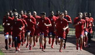 Members of the Philadelphia Phillies run during a spring training baseball workout Thursday, Feb. 16, 2017, in Clearwater, Fla. (AP Photo/Matt Rourke)