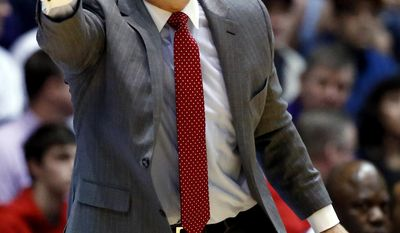 Rutgers head coach Steve Pikiell directs his team during the first half of an NCAA college basketball game against Northwestern Saturday, Feb. 18, 2017, in Evanston, Ill. (AP Photo/Nam Y. Huh)
