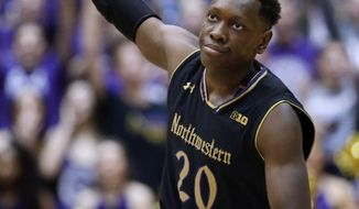Northwestern guard Scottie Lindsey reacts after hitting a three-point shot against Rutgers during the first half of an NCAA college basketball game Saturday, Feb. 18, 2017, in Evanston, Ill. (AP Photo/Nam Y. Huh)