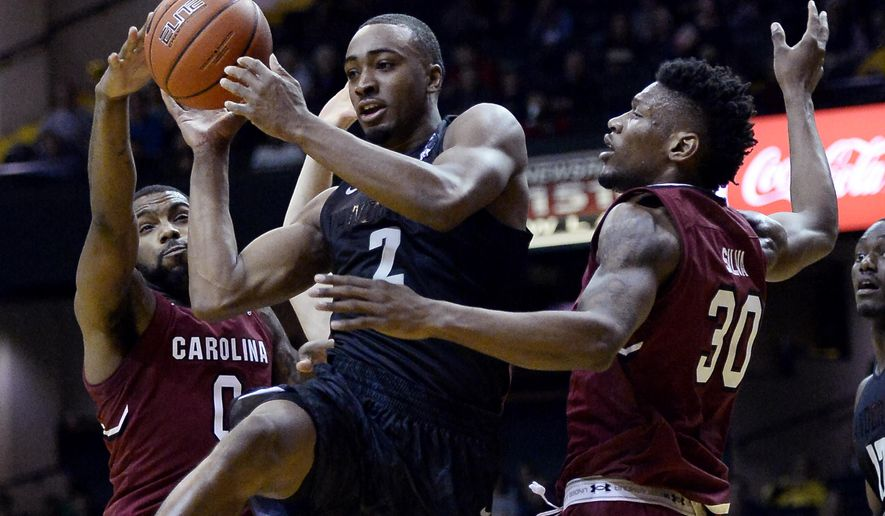 Vanderbilt guard Joe Toye (2) passes the ball between South Carolina guard Sindarius Thornwell (0) and forward Chris Silva (30) in the first half of an NCAA college basketball game, Saturday, Feb. 18, 2017, in Nashville, Tenn. (AP Photo/Mark Zaleski)