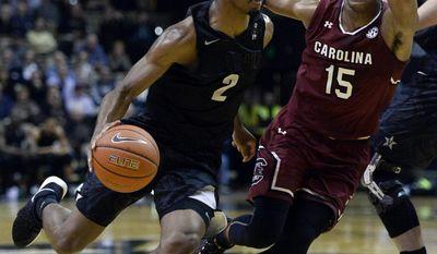 Vanderbilt guard Joe Toye (2) drives past South Carolina guard P.J. Dozier (15) in the first half of an NCAA college basketball game, Saturday, Feb. 18, 2017, in Nashville, Tenn. (AP Photo/Mark Zaleski)