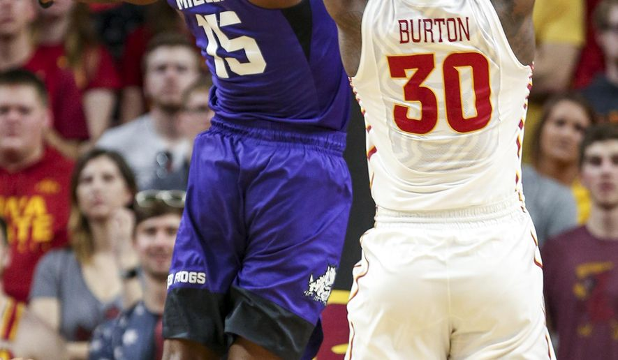 TCU forward JD Miller and Iowa State guard Deonte Burton fight for a rebound during the first half of an NCAA college basketball game, Saturday, Feb. 18, 2017, in Ames, Iowa. (AP Photo/Justin Hayworth)