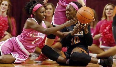 Oklahoma's LaNesia Williams (1) and Texas' Lashann Higgs (10) fight for a ball during NCAA college basketball at The Lloyd Noble Center, Saturday, Feb. 18, 2017 in Norman, Okla. (Steve Sisney/The Oklahoman via AP)