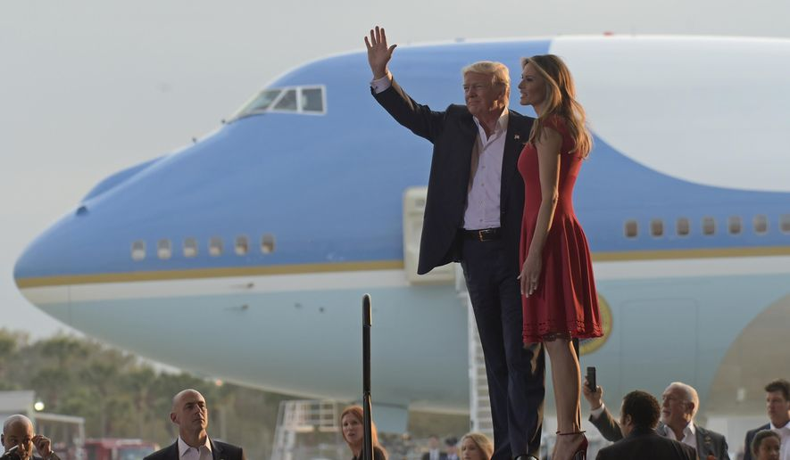 "President Donald Trump and first lady Melania Trump arrive for the ""Make America Great Again Rally"" at Orlando-Melbourne International Airport in Melbourne, Fla., Saturday, Feb. 18, 2017. (AP Photo/Susan Walsh)"