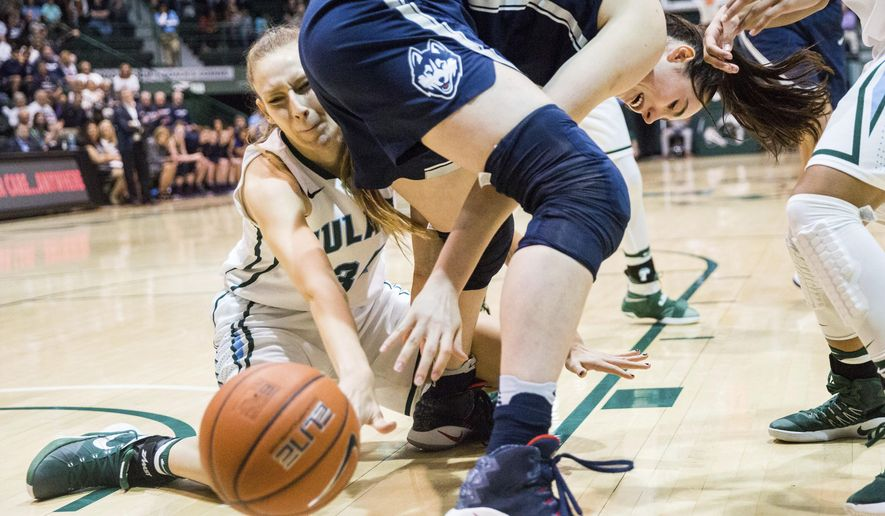 Tulane center Ksenija Madzarevic (34) tries to get the ball after Conneticut's Natalie Butler (51) losy control of it during the first half of an NCAA college basketball game in New Orleans, Saturday, Feb. 18, 2017. (AP Photo/Sophia Germer)