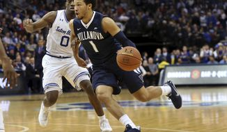 Villanova's Jalen Brunson (1) drives to the basket as Seton Hall's Khadeen Carrington (0) defends during the first half of an NCAA college basketball game, Saturday, Feb. 18, 2017, in Newark, N.J. (AP Photo/Mel Evans)