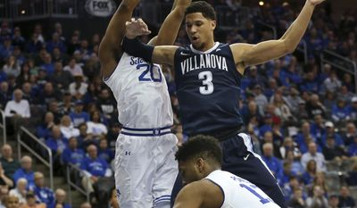 Seton Hall's Myles Powell (13) strips the ball as Villanova's Josh Hart (3) goes up for a shot against Seton Hall's Desi Rodriguez (20) during the first half of an NCAA college basketball game, Saturday, Feb. 18, 2017, in Newark, N.J. (AP Photo/Mel Evans)