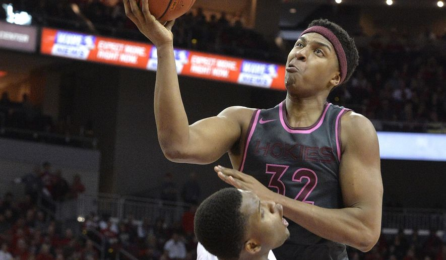 Virginia Tech's Zach LeDay (32) is blocked by Louisville's Jaylen Johnson (10) during the first half of an NCAA college basketball game, Saturday, Feb. 18, 2017, in Louisville, Ky. (AP Photo/Timothy D. Easley)