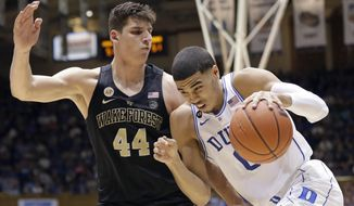 Duke's Jayson Tatum drives to the basket while Wake Forest's Konstantinos Mitoglou (44) defends during the second half of an NCAA college basketball game in Durham, N.C., Saturday, Feb. 18, 2017. Duke won 99-94. (AP Photo/Gerry Broome)