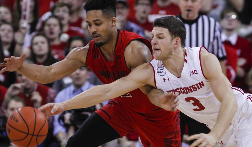 Maryland's Melo Trimble, left, and Wisconsin's Zak Showalter (3) go after the during the second half of an NCAA college basketball game Sunday, Feb. 19, 2017, in Madison, Wis. (AP Photo/Andy Manis)