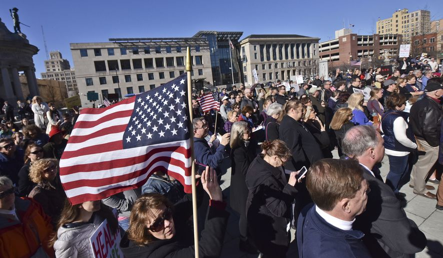 A large crowd gathers for the rally outside the Lackawanna County Courthouse in Scranton Pa., Sunday Feb. 19, 2017, to focus on protecting the Affordable Care Act, Medicare and Medicaid. (Jason Farmer/The Times & Tribune via AP)