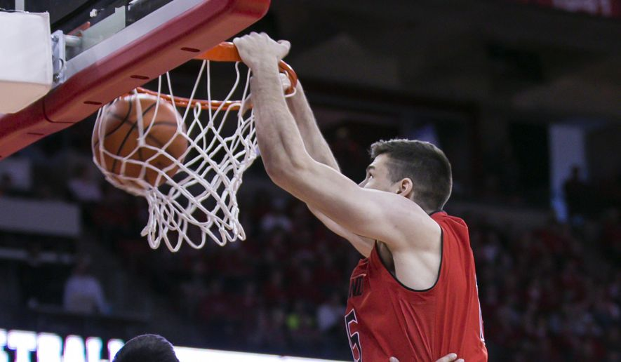 Maryland's Michal Cekovsky, right, dunks over Wisconsin's Bronson Koenig (24) during the first half of an NCAA college basketball game Sunday, Feb. 19, 2017, in Madison, Wis. (AP Photo/Andy Manis)