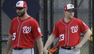 Washington Nationals first baseman Adam Lind (73) watches during a spring training baseball workout Sunday, Feb. 19, 2017, in West Palm Beach, Fla. (AP Photo/David J. Phillip)