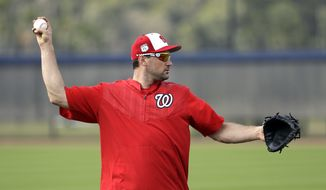 Washington Nationals first baseman Ryan Zimmerman throws during a spring training baseball workout Sunday, Feb. 19, 2017, in West Palm Beach, Fla. (AP Photo/David J. Phillip)
