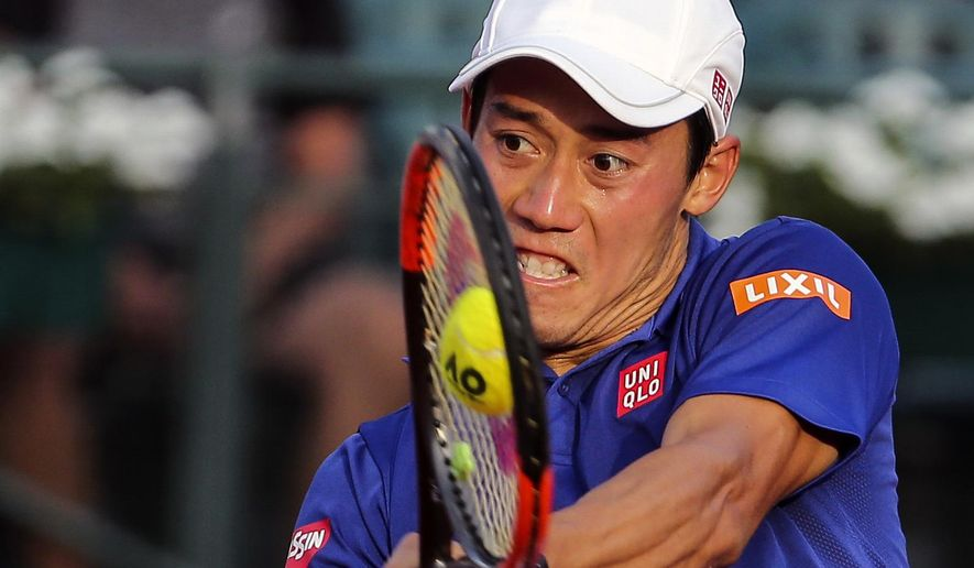 Kei Nishikori of Japan returns a shot to Carlos Berlocq of Argentina, during an ATP Argentina Open match in Buenos Aires, Argentina, Saturday, Feb. 18, 2017. (AP Photo/Agustin Marcarian)