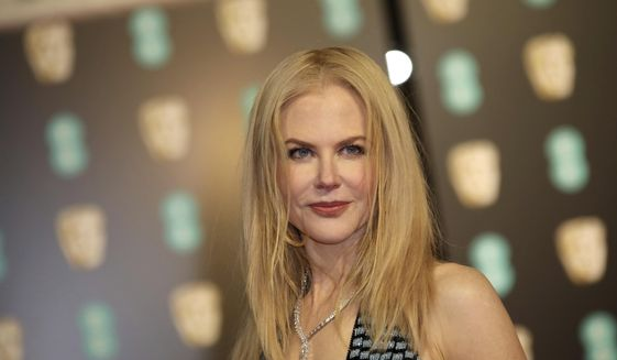 Actress Nicole Kidman poses for photographers upon arrival at the British Academy Film Awards in London, Sunday, Feb. 12, 2017. (Photo by Vianney Le Caer/Invision/AP)