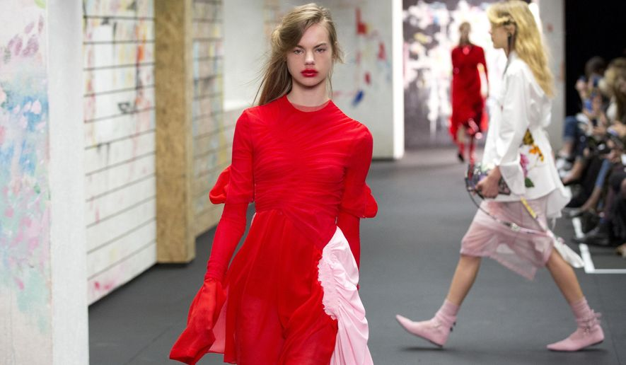 Models wear creations by Preen during the Autumn/Winter 2017 London Fashion Week as part of London Fashion Week, Sunday Feb. 19, 2017. (Isabel Infantes/PA via AP)
