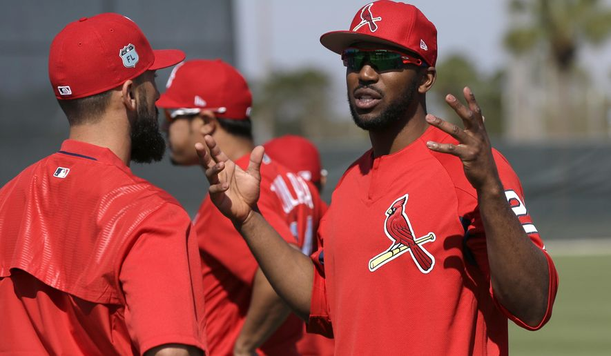 St. Louis Cardinals' Dexter Fowler, right, talks with Matt Carpenter during a spring training baseball workout Friday, Feb. 17, 2017, in Jupiter, Fla. (AP Photo/David J. Phillip)