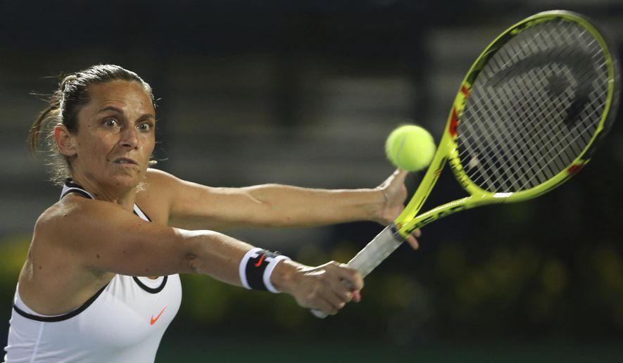 Roberta Vinci of Italy returns the ball to Kristyna Pliskova of Czech Republic during the Dubai Tennis Championships, in Dubai, United Arab Emirates, Sunday, Feb. 19, 2017. (AP Photo/Kamran Jebreili)
