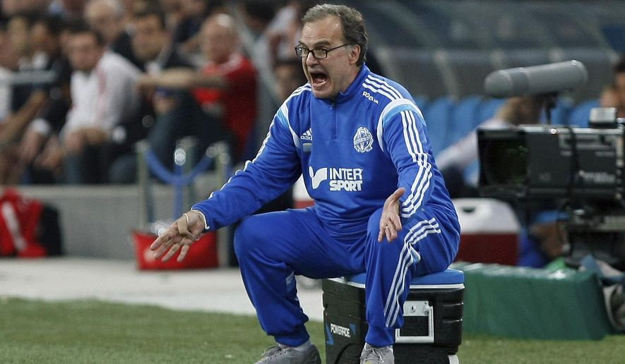 FILE - In this May 10, 2015 file photo, Marseille's coach Marcelo Bielsa, of Argentina, shouts instructions during a League One soccer match between Marseille and Monaco in Marseille, France. Controversial coach Marcelo Bielsa is returning to French football to take charge of Lille in the summer of 2017 (AP Photo/Claude Paris, FILE)