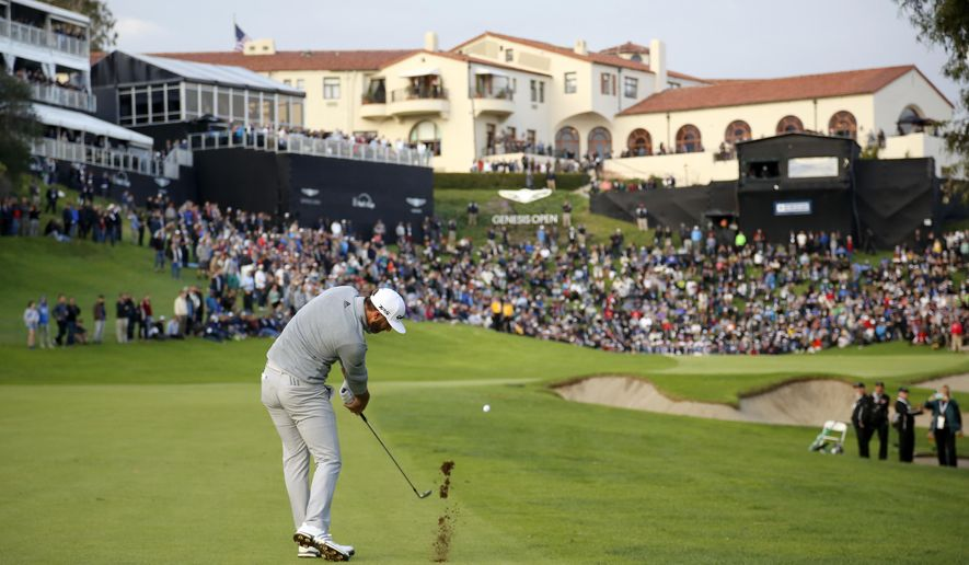 Dustin Johnson hits his approach shot on the 18th fairway during the final round of the Genesis Open golf tournament at Riviera Country Club on Sunday, Feb. 19, 2017, in the Pacific Palisades area of Los Angeles. (AP Photo/Ryan Kang)