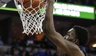 Georgetown's Jessie Govan dunks during the first half of an NCAA college basketball game against Creighton in Omaha, Neb., Sunday, Feb. 19, 2017. (AP Photo/Nati Harnik) **FILE**