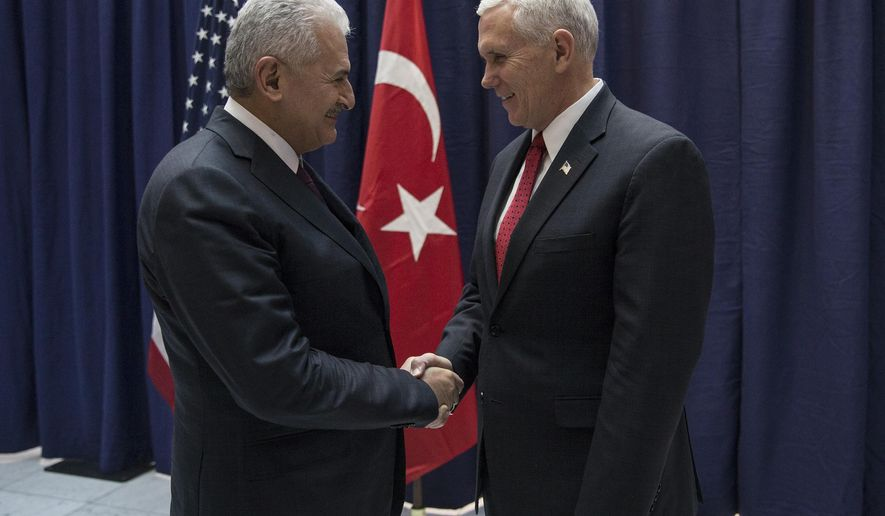 "United States Vice President Mike Pence, right, and Turkey's Prime Minister Binali Yildirim, left, talk prior to their meeting during the Munich Security Conference in Munich, Germany, Saturday, Feb. 18, 2017.   America's commitment to NATO is ""unwavering,"" Pence said Saturday, reassuring allies about the direction the Trump administration might take but leaving open questions about where Washington saw its relationship with the European Union and other international organizations. (Prime Minister's Press Service, Pool Photo via AP)"