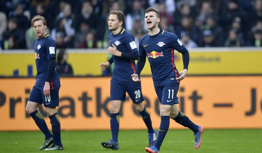 Leipzig's Timo Werner, right, celebrates after scoring during the German Bundesliga soccer match between Borussia Moenchengladbach and RB Leipzig in Moenchengladbach, Sunday, Feb. 19, 2017. (AP Photo/Martin Meissner)