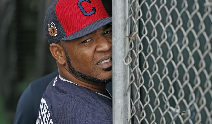 Cleveland Indians first baseman and designated hitter Edwin Encarnacion watches the rain fall from the batting cages at the Indians baseball spring training facility, Sunday, Feb. 19, 2017, in Goodyear, Ariz. (AP Photo/Ross D. Franklin)