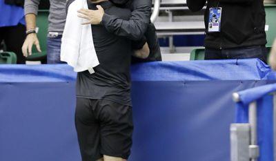 Ryan Harrison hugs his coach, Peter Lucassen, right, after defeating Nikoloz Basilashvili in the singles championship at the Memphis Open tennis tournament Sunday, Feb. 19, 2017, in Memphis, Tenn. (AP Photo/Mark Humphrey)