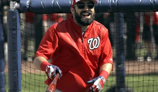 Washington Nationals center fielder Adam Eaton laughs while taking batting practice during a spring training baseball workout Sunday, Feb. 19, 2017, in West Palm Beach, Fla. Eaton, who is expected to start in center field and bat first or second in the lineup, began showing the Nationals what he can do during Sunday's first official full-squad workout of spring training. (AP Photo/David J. Phillip)