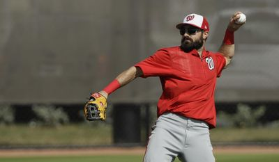 Washington Nationals center fielder Adam Eaton throws during a spring training baseball workout Sunday, Feb. 19, 2017, in West Palm Beach, Fla. Eaton, who is expected to start in center field and bat first or second in the lineup, began showing the Nationals what he can do during Sunday's first official full-squad workout of spring training. (AP Photo/David J. Phillip)