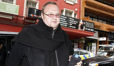 FILE - In this Nov. 27, 2014, file photo, Kim Dotcom arrives at Auckland District Court in Auckland, New Zealand. A New Zealand judge on Monday, Feb. 20, 2017, upheld an earlier court ruling that flamboyant internet entrepreneur Kim Dotcom and three of his colleagues can be extradited to the U.S. to face criminal charges. The decision comes five years after U.S. authorities shut down Dotcom's file-sharing website Megaupload and filed charges of conspiracy, racketeering and money laundering against the men. (Chris Gorman/New Zealand Herald via AP, File)