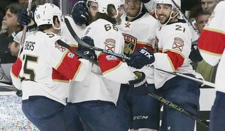 Florida Panthers celebrate a goal by left winger Jonathan Huberdeau against the Los Angeles Kings during the first period of an NHL hockey game in Los Angeles Saturday, Feb. 18, 2017. (AP Photo/Reed Saxon)