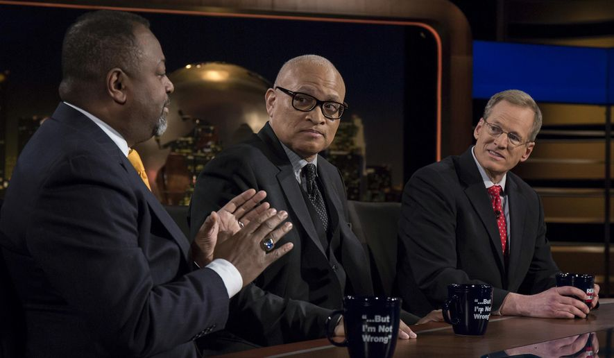 "In this Friday, Feb. 17, 2017 photo provided by HBO, Malcolm Nance, author and counterterrorism expert, speaks as comedian Larry Wilmore, center, and former Rep. Jack Kingston, (R-GA), listen while appearing on HBO's ""Real Time with Bill Maher,"" in Los Angeles. (Janet Van Ham/HBO via AP)"