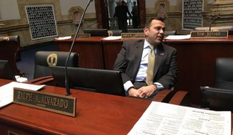 In a Monday, Feb. 13, 2017 photo, Kentucky Republican state Sen. Ralph Alvarado sits in the Senate floor in Frankfort, Ky. Alvarado, a medical doctor in the Kentucky Senate, is leading the effort to restrict smoking in a state that leads the country in smoking rates. (AP Photo/Adam Beam)