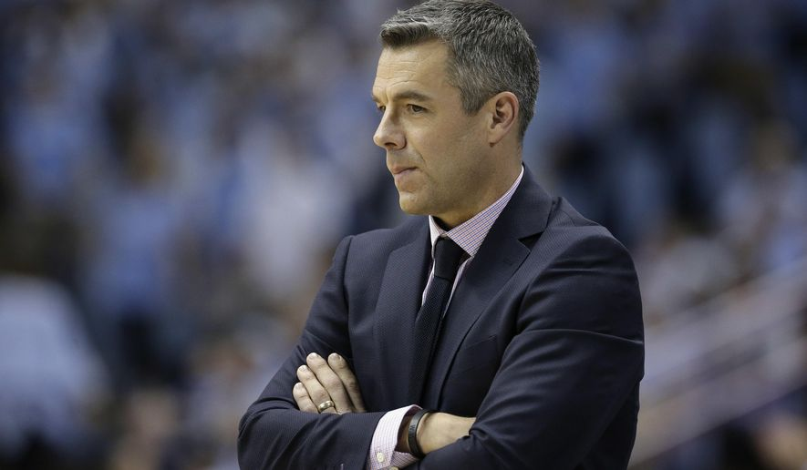 Virginia head coach Tony Bennett watches during the second half of an NCAA college basketball game against North Carolina in Chapel Hill, N.C., Saturday, Feb. 18, 2017. North Carolina won 65-41. (AP Photo/Gerry Broome)